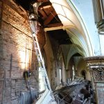VA technician accesing the roof structure at the north nave